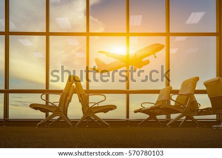 passenger seat in Departure lounge for see Airplane, view from airport terminal.sun light in vintage color selective focus,transport and travel concept