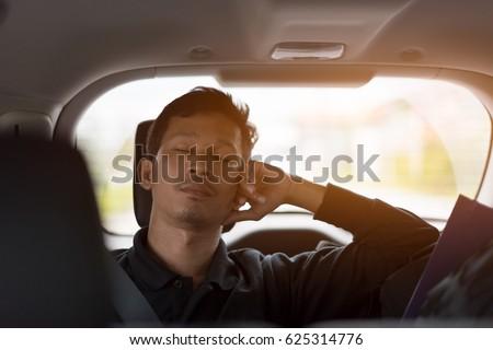 Passenger sleep in car.