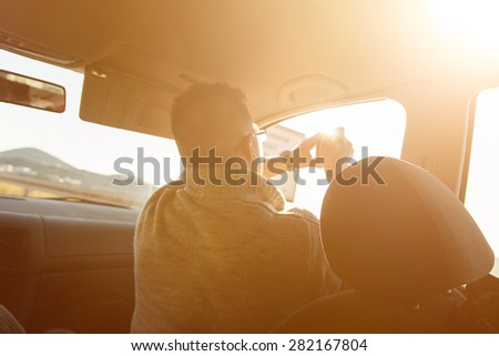 passenger taking photo of the beautiful landscape