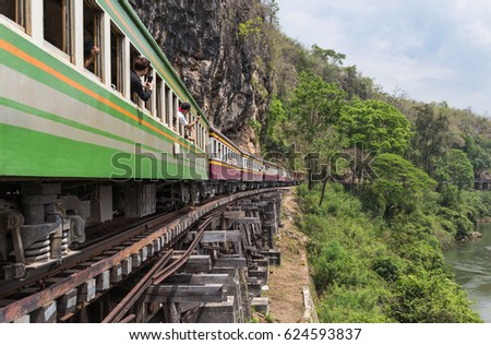 passenger thai train moving on death of railway world war II between tham krasae railway station river kwai kanchanaburi Thailand