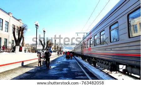 passenger train stops at the...