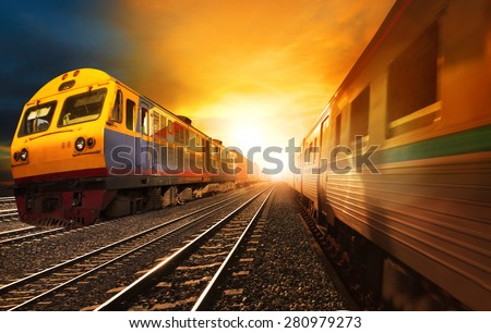 passenger trains and industry container  railroads running on railways track against beautiful sun set sky use for land transport and logistic business