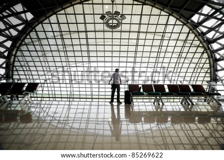 passenger waiting at an airport - stock photo