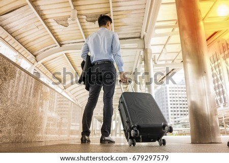 Passenger  walking in passenger terminal at the airport.business trip concept