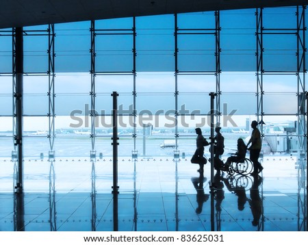 passengers and disabled person in the interior of the airport