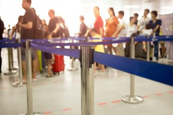 Passengers check-in line at the airport on vacation