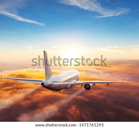 Passengers commercial airplane flying above clouds in sunset light. Concept of fast travel, holidays and business. #1471761293