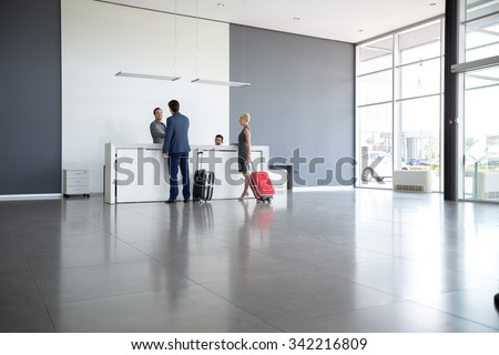 Passengers departing from business trip at hotel reception  #342216809