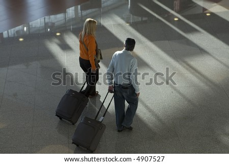 passengers in the airport with their baggage and luggage