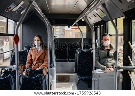 Passengers on public transport during the coronavirus pandemic keep their distance from each other. Protection and prevention covid 19 Foto stock ©