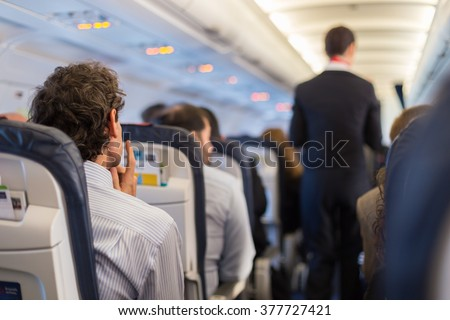 Passengers on the airplane.