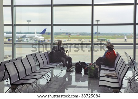 Passengers waiting at the airport.