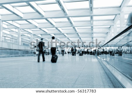 Passengers walking in the airport channel