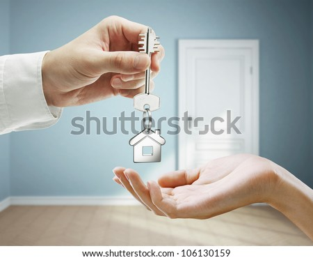 passing keys against backdrop of blue room