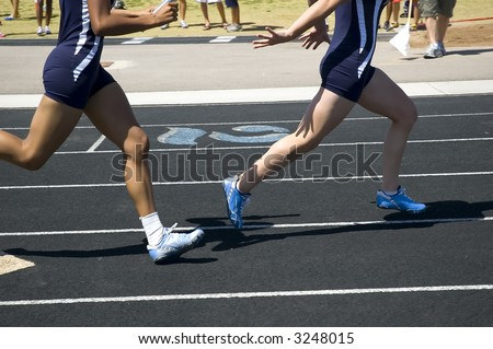Passing the baton during relay competition
