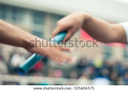 Passing the Baton with motion hand ,very fast run - stock photo