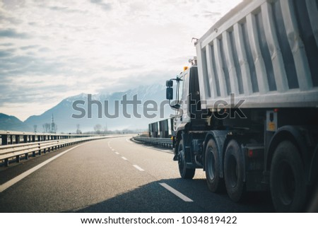 Passing trucks on the highway  #1034819422