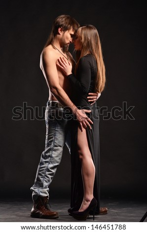 Passion couple in love on dark bacjground
