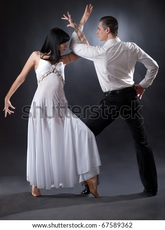 passion dancers in white clothes over grey background