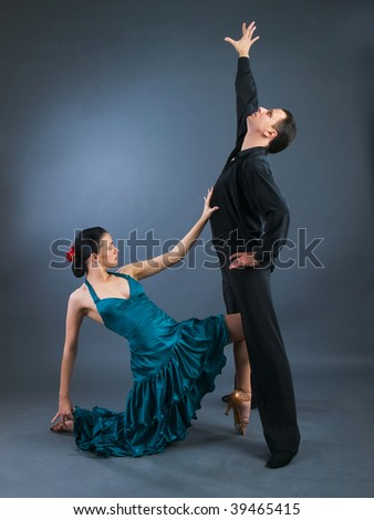 passion flamenco dancers over grey background
