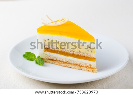 Passion fruit cake, mousse dessert on a white plate.
