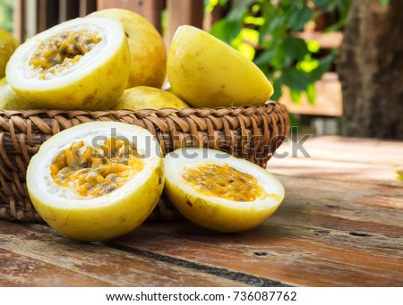 Passion fruit in bamboo basket. Tropical fruit. Sour taste, higth vitamin. Diet dessert. On wooden table.