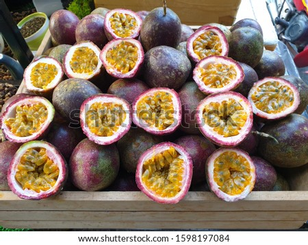Passion fruit Passion fruit half cut from the garden On a brown wooden crate