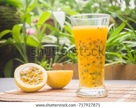 Passion fruit - Passion fruits half and juice on green background