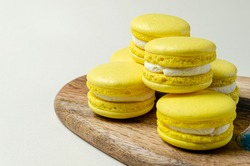passion fruit pasta cookies.Yellow multi-layer cookies with filling on a wooden stand High quality photo