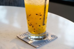 Passion fruit punch. Juice is a drink made from the extraction or pressing of the natural liquid contained in fruit and vegetables. It can also refer to liquids that are flavored with concentrate.