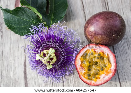 Passion fruit with blossom on a wooden table with view from above