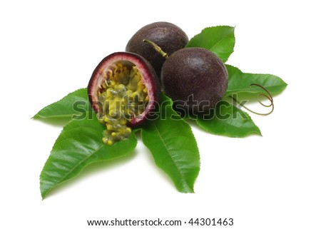 Passion fruits with leaves and pulp spilling isolated on white with clipping path