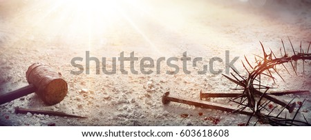 Passion Of Jesus Christ - Hammer and Bloody Nails And Crown Of Thorns On Arid Ground - Shutterstock ID 603618608