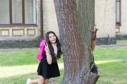 Passionate about studying Zoology. Happy child show peace sign. Red squirrel climb tree trunk. Animal science. Zoology. Back to school. Natural science education. Becoming zoologist is in her future.