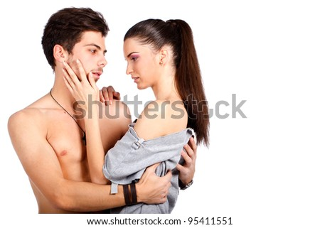 Passionate couple hugging flirting and getting ready for a kiss. Isolated on white background. High resolution studio image