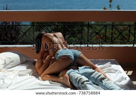 Passionate couple kissing, boy and girl. Having sex. Young lovers. People in love. Positions kamasutra. Erotic moments. Concept photo. Secret. Fashion. Hot babe. Party. Night background. Sex couple. #738758884