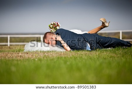 Passionate couple kissing on lawn - stock photo