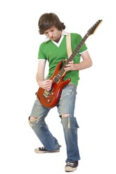 Passionate guitarist playing his electric guitar on white background