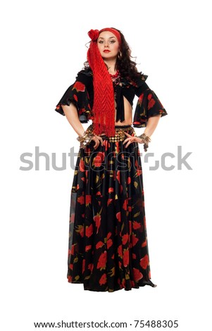 Passionate gypsy woman in a black skirt. Isolated