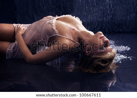 Passionate Sexy lady lies on the floor in the aqua studio