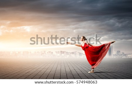 Passionate woman dancer in red dress reaching her hand #574948063