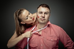 Passionate woman embracing and kissing a macho man
