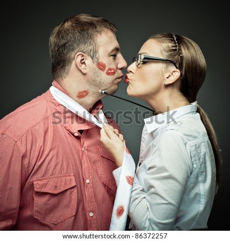 Passionate woman embracing and kissing a macho man - stock photo