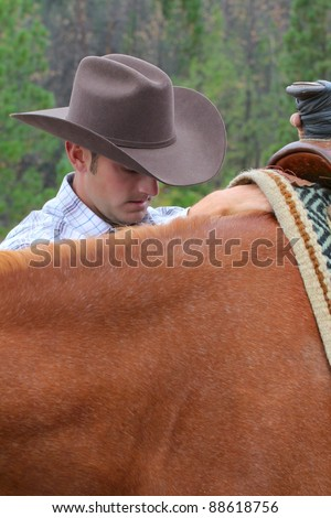 Passionate young cowboy spending time with his horse