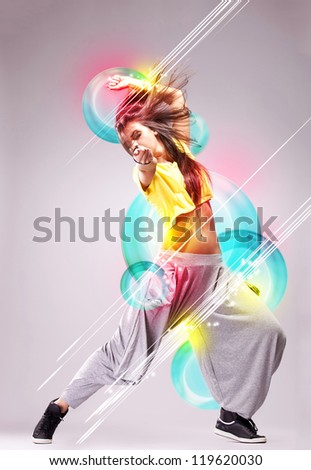 passionate young woman dancer in a beautiful dreamy pose on a colorful background