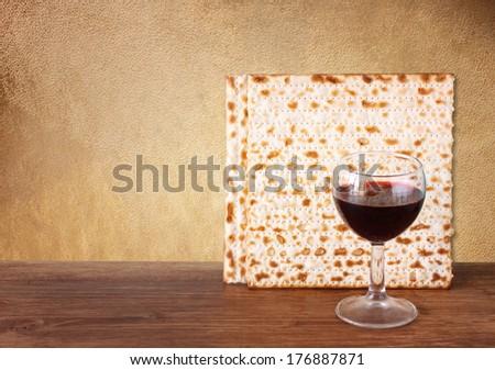 passover background. wine and matzoh (jewish passover bread)  over brown antique background.