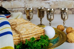 Passover holiday traditional celebration with four cup wine kosher matzah unleavened bread on of Jewish Pesach