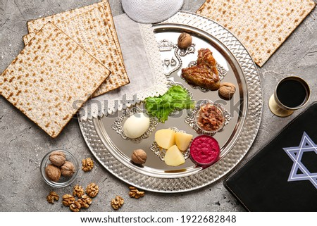 Passover Seder plate with traditional food on grunge background