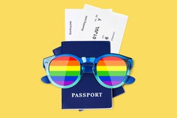 Passport, airplane boarding pass, flight ticket, sunglasses LGBTQ community flag color, rainbow glasses, LGBT pride people summer holidays travel, gay, lesbian etc couple vacation, tourism, copy space