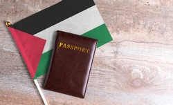 Passport and a Western Sahara flag on a wooden background. Travel concept